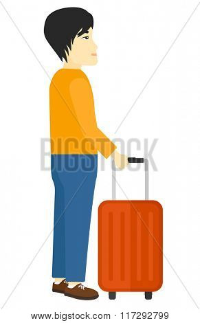 Man standing with suitcase.