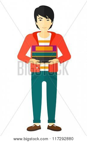 Man holding pile of books.