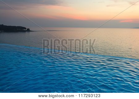 Swimming Pool With Sunset On The Sea