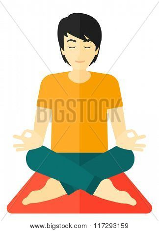 Man meditating in lotus pose.