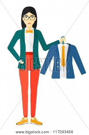 Woman holding jacket.
