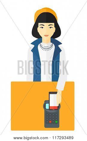 Customer paying using smartphone.