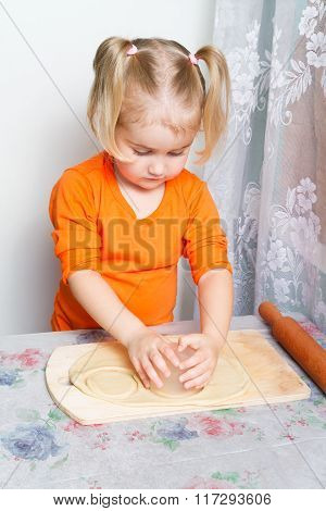 Little Girl Making Dough In The Kitchen.