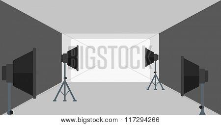 Background of empty photo studio with lighting equipment.