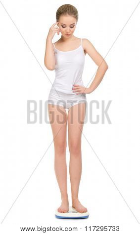 Young healthy girl on scales isolated