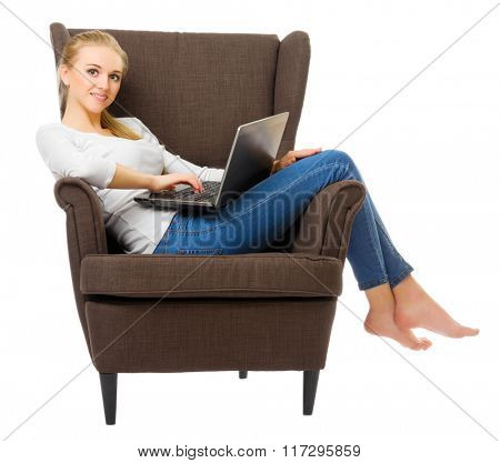 Youn girl with laptop in chair isolated