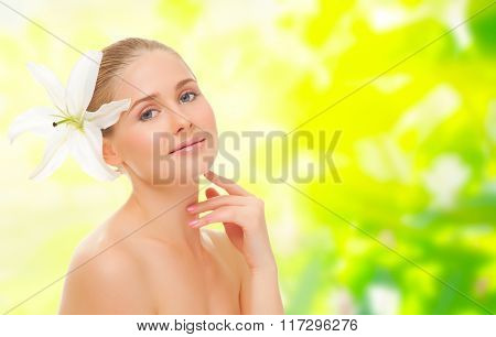 Young healthy girl with flower  on floral spring background