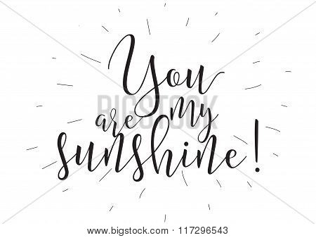 You are my sunshine inscription. Greeting card with calligraphy. Hand drawn design elements. Black a