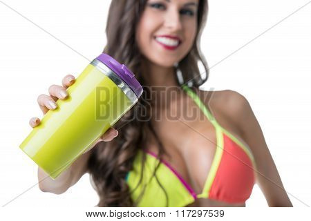 Focus on shaker in hands of charming smiling woman
