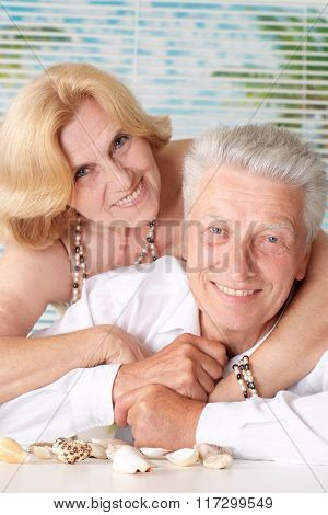 Elderly couple with seashells