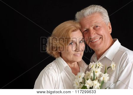 Nice old people with flowers