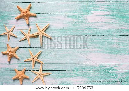 Marine Items ( Sea Stars) On Wooden Background.