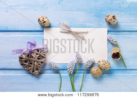 Decorative Heart, Eggs, Spring Flowers On  Blue Wooden Background.