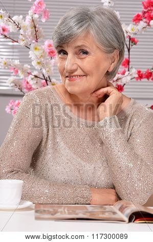happy aged woman drinking coffee