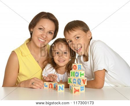 Mother and  kids playing with cubes