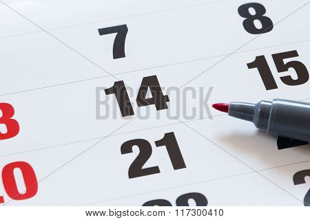 Setting An Important Date On A Calendar With A Red Pencil Marking A Day Of The Month Representing Or