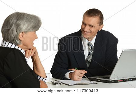 Businesspeople at workplace with laptop