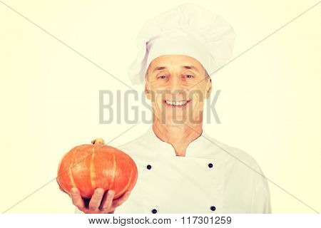 Male chef with a pumpkin