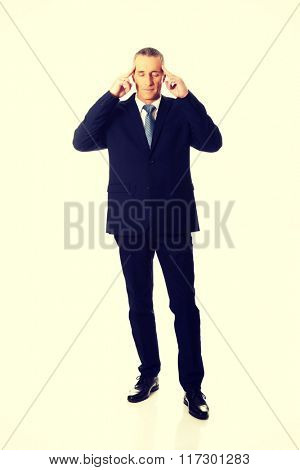 Pensive businessman touching head