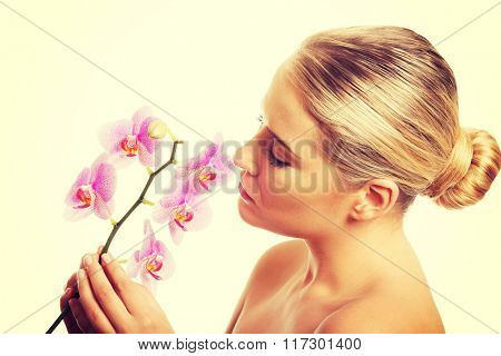 Spa woman with purple orchid
