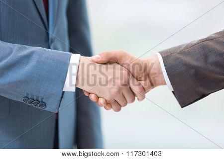 Men handshake isolated