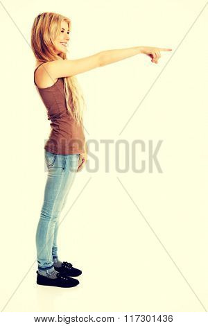 Student woman pointing on the right