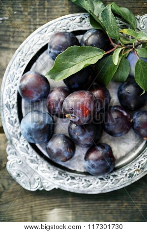 plums on a metal tray
