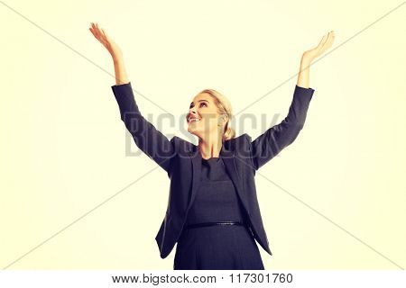 Beautiful woman raising arms high