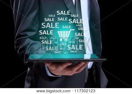 Businessman hand touch online shopping icons on a tablet. sale