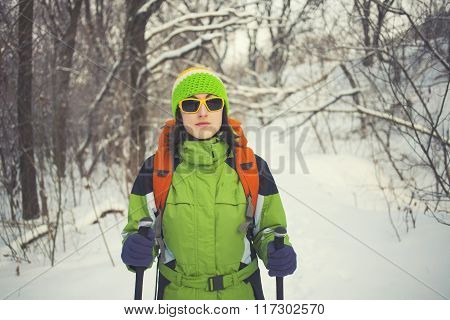 Beautiful Girl With Glasses Is Standing In The Forest.