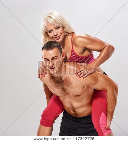 man woman piggybacked. fitness portrait