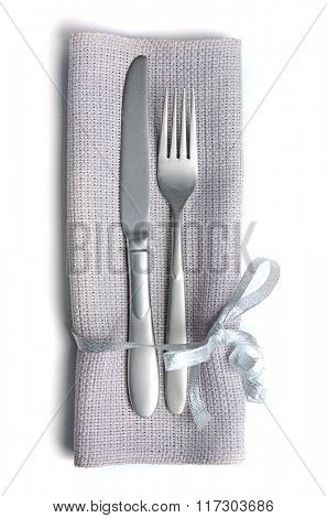 Christmas serving cutlery with a napkin, isolated on white