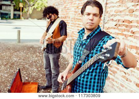 Tuning his guitar