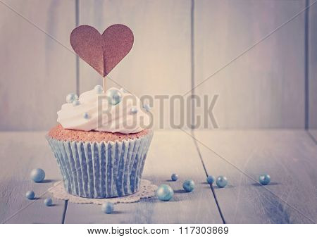 Cupcakes with heart cakepick for text