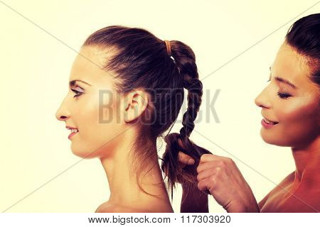 Woman making a tress her friend.