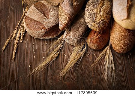 Fresh baked bread on the wooden background