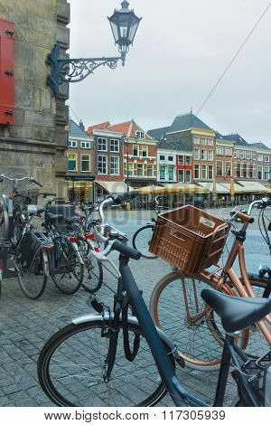 Old town square or Dutch Markt with bicycle parking lot in Delft Netherlands