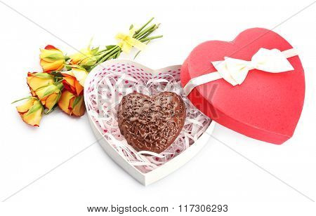 Heart shaped box and candy with flowers, isolated on white
