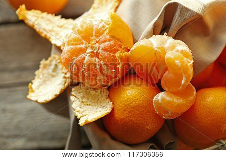 Tangerines on old wooden table, close up