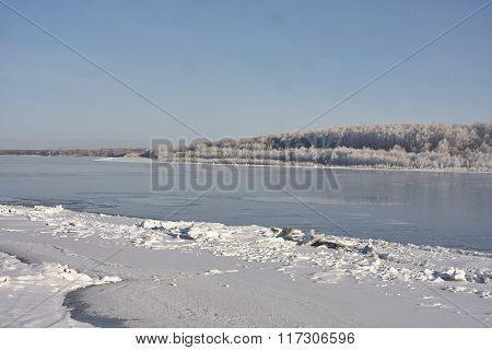 Irtish in deep autumn. Ice on banks hoarfrost clear sky blue sky. clean white snow. Russia Sibe
