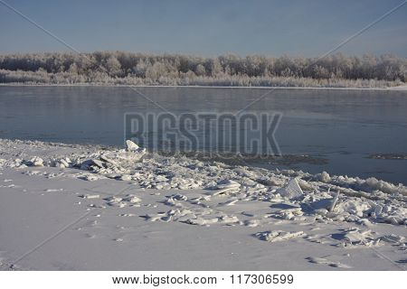 Irtish in deep autumn. Ice on banks hoarfrost clear sky blue sky. clean white snow. Russia Siberia.