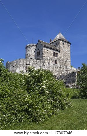View On Bedzin Castle In Poland On A Background Of Blue Sky