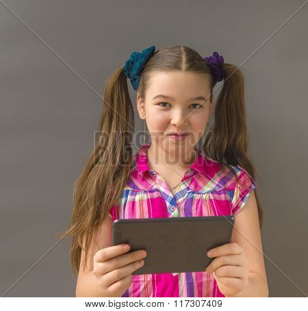 Closeup portrait teenager shocked, surprised, funny looking girl  using, holding laptop pad computer
