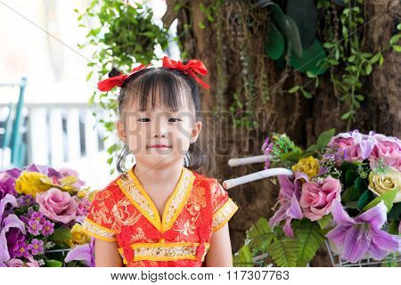 Cute Asian Little Girl Wearing Red Traditional Chinese Suit