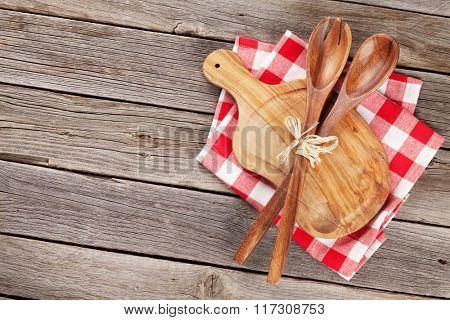 Cooking utensils on wooden table. Top view with copy space