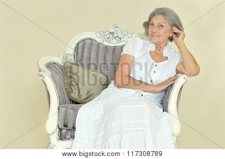 elderly woman on  vintage chair