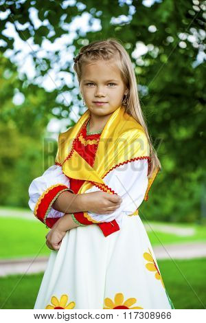 Close up Little girl is dressed in the Russian national dress Ã??Ã?? summer park