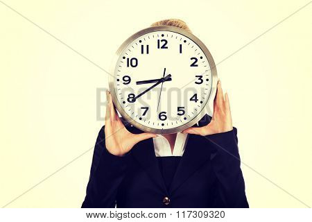 Businesswoman with clock - time concept