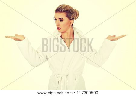 Young surprised woman after bath holding something