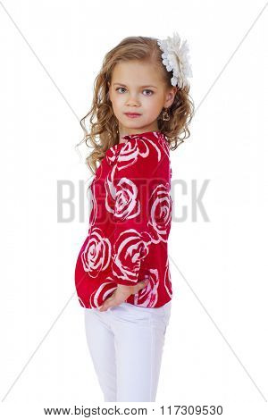 Portrait of a charming little girl looking at camera, isolated on white background
